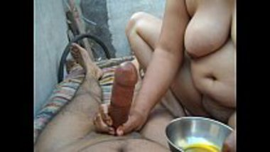 Naked aunty giving an oil massage to the penis
