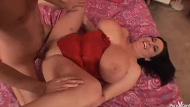 Brunette with enormous tits rides a stiff cock